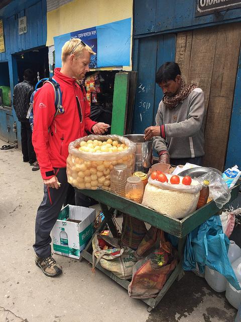 Ben trying gol gappas (Indian street food)