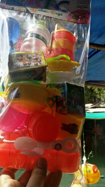Toys on sale. Notice Amul Butter, Bisleri bottle and Taj Mahal tea